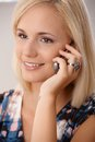 Beautiful blonde with cellphone portrait of young woman using smiling Royalty Free Stock Photography
