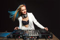Beautiful blonde DJ girl on decks - the party Royalty Free Stock Photo