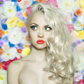 Beautiful blonde fashion portrait of on flower background Stock Images