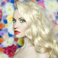 Beautiful blonde fashion portrait of on flower background Royalty Free Stock Photo