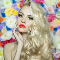 Beautiful blonde fashion portrait of on flower background Royalty Free Stock Photography