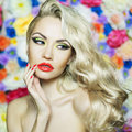 Beautiful blonde fashion portrait of on flower background Stock Photos