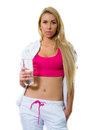 Beautiful blond girl with bottle of water over white background Royalty Free Stock Photo