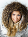 Beautiful blonde girl in fur hood Royalty Free Stock Images