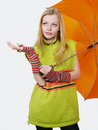 Beautiful blonde girl with orange umbrella Royalty Free Stock Photo
