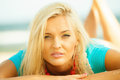 Beautiful blonde girl relaxing on beach Royalty Free Stock Photo