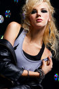 Beautiful blonde girl rocker Stock Images