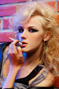 Beautiful blonde girl smoking Royalty Free Stock Images