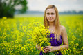 Beautiful blonde girl on summer meadow Royalty Free Stock Photo