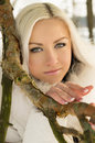 Beautiful blonde girl tree winter Stock Photos