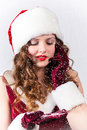 Beautiful blonde girl in xmas clothes with cellphone on white portrait of Royalty Free Stock Image