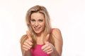 Beautiful blonde giving a thumbs up gesture Royalty Free Stock Image