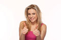 Beautiful blonde giving a thumbs up gesture Royalty Free Stock Photography