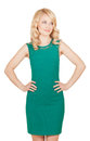 The beautiful blonde in green dress has his hands on the waist Stock Photography