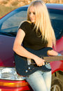 Beautiful blonde with a guitar Stock Image
