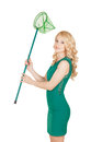 The beautiful blonde holds a net green dress Royalty Free Stock Image