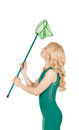 The beautiful blonde holds a net green dress Stock Image