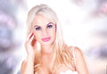 Beautiful blonde in lingerie infront of shining background Royalty Free Stock Image