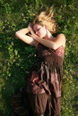 Beautiful blonde lying on the grass Royalty Free Stock Photo