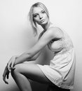 Beautiful blonde model sitting on a stool Royalty Free Stock Photo