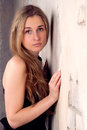 Beautiful blonde near the wall Royalty Free Stock Photography