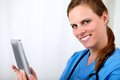 Beautiful blonde nurse smiling with a tablet PC Royalty Free Stock Photo