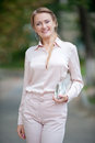 Beautiful blonde photo of a young woman in a bright pantsuit Royalty Free Stock Photography