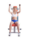 Beautiful blonde on power exerciser Royalty Free Stock Photos