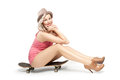 Beautiful blonde with a skateboard Royalty Free Stock Photo