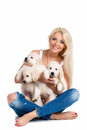 Beautiful blonde with a small white puppy of labrador smiling young woman pet studio shot close up woman in sweater retriever love Royalty Free Stock Image