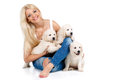 Beautiful blonde with a small white puppy of labrador smiling young woman pet studio shot close up woman in sweater retriever love Royalty Free Stock Images