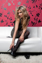 Beautiful blonde on the sofa Royalty Free Stock Photo