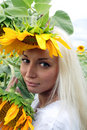 Beautiful blonde with sunflower Royalty Free Stock Photo