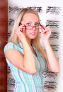 Beautiful blonde tries on glasses Royalty Free Stock Image