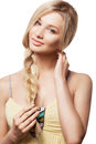 Beautiful blonde woman with braid hairdo young and hand text to heу neck looking at camera Royalty Free Stock Photography