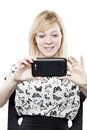 Beautiful blonde woman in business attire holding mobile phone taking picture Stock Photos