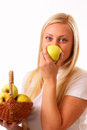 Beautiful blonde woman eating apple Stock Photography