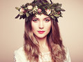 Beautiful blonde woman with flower wreath on her head Royalty Free Stock Photo