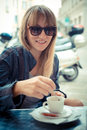 Beautiful blonde woman having breakfast at the bar in city Stock Photos