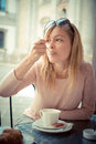 Beautiful blonde woman having breakfast at the bar Royalty Free Stock Photo