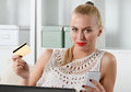 Beautiful blonde woman holding golden credit Royalty Free Stock Photo