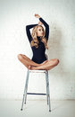 Beautiful blonde woman model sitting on a chair. long hair Royalty Free Stock Photo