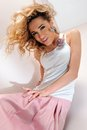 Beautiful blonde woman in pink scirt. Royalty Free Stock Photo