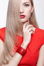 Beautiful blonde woman portrait of young long haired in red dress with hair covering half of her face Stock Photography