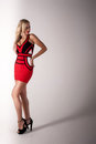 Beautiful blonde woman  in red dress Royalty Free Stock Photo