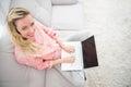 Beautiful blonde woman using laptop Royalty Free Stock Photo