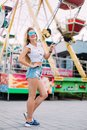 Beautiful blonde woman wearing sunglasses close-up portrait of a young girl hipster in the park attraction Street fashion con Royalty Free Stock Photo