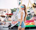Beautiful blonde woman wearing sunglasses close-up portrait of a young girl hipster in the park attraction.Stylish happy youn Royalty Free Stock Photo