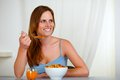Beautiful blonde young woman eating breakfast Royalty Free Stock Photography