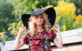 Beautiful blondie in a big hat Royalty Free Stock Photography
